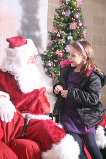 Christmas at the Park kicked off at Graham Memorial Park Nov. 23. Katelynn Deering, 8, of Lebanon chats with Santa Claus about what she would like for Christmas.