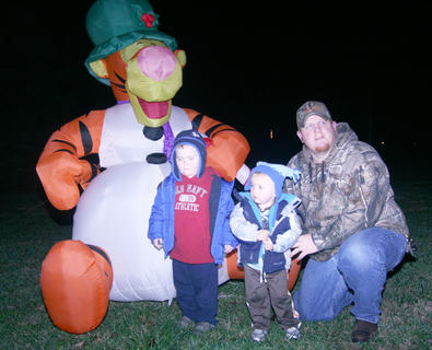 Kevin Purdom of Bradfordsville poses for photos with his sons, Kyle, 3, and Wesley, 1.
