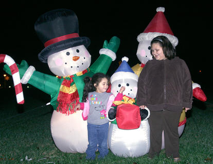 Madison Garrett, 3, plays with the nose of a baby snowman as Hope Orberson, 9, of Bradfordsville watches.