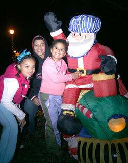 Ava, Dakin and Alex Caldwell gather around Santa, who was himself aboard a train.