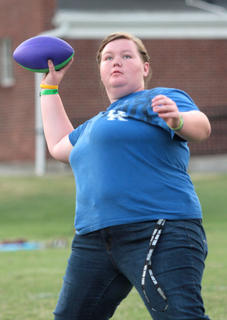 Jessie Tungate tosses a football around with her friends.