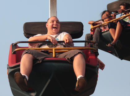Anthony Vorpahl of Campbellsville points to a friend while riding the Superman.