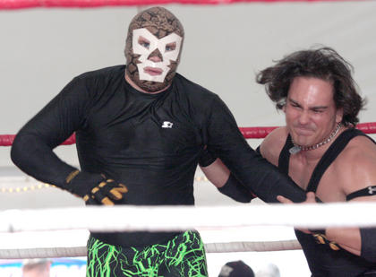 U.S. Champion Jarrod Slone slings the Masked Superstar into the ropes during a USWF match Wednesday night.