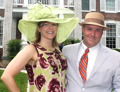 Party hosts Wendy Smith and James Spragens pose for a photo in front of their home - Myrtledene Bed & Breakfast.