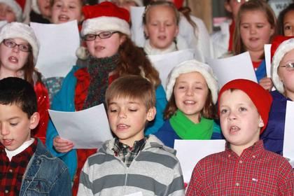 Local students sang Christmas carols in front of the old Marion County Courthouse.