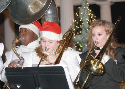 Members of the Marion County High School Band played Christmas music in front of the fountain at Farmers National Bank.