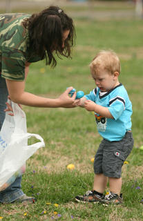 Jeremy Bagwell, 21 months, wasn't so happy about mom, Jessica Bagwell, putting his egg in a bag for him.