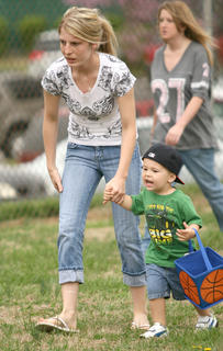 Ashley Walston and her son Reese Medina, 2, hunt for eggs together.
