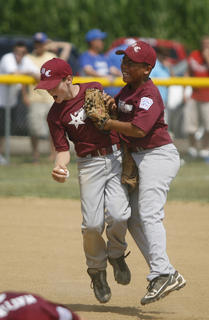 Trent Farmer, left, and Jaren Epps celebrate the Marion County's win in the 9-10 year old District 5 Little League baseball championship.