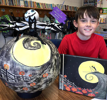 """West Marion Elementary School student Ethan Essex is pictured with his Jack Skellington-themed pumpkin from""""The Nightmare Before Christmas."""""""