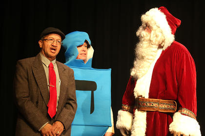 "John R. Mattingly plays Martin Luther King Jr., Diane Thomas plays a Dreidel and Chris Howlett plays Santa in ""Holiday Celebrities."""