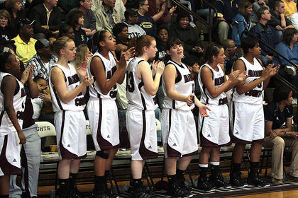 The Lady Knight bench stands in support of their team during the 5th Region championship game.