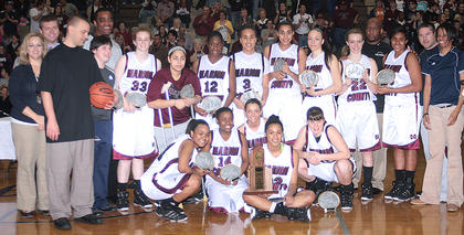 The Lady Knights team, coaching staff and high school administration pose for a photo after winning the 5th Region Championship.