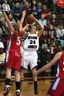 Junior Bre Elder shoots over Elizabethtown&#039;s Natalie Greenwell. The Lady Knights defeated the Lady Panthers by a final score of 53-52.