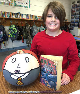 """West Marion Elementary School student Josie Essex is pictured with her Hermione-themed pumpkin fromthe """"Harry Potter and The Prisoner of Azkaban"""" book."""