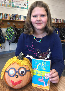 """West Marion Elementary School student Kaitlyn Lyvers is pictured with her Sophie-themed pumpkin from""""The BFG"""" book."""