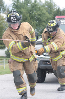 The Mark Mattingly Loretto Homecoming was held Oct. 1. The activities included a softball games between the Loretto, a comedy/hypnotist show, live and silent auctions, and the Tim Fowler Firefighter Challenge. Teams from Loretto, Northeast Nelson and Raywick competed in the firefighter challenge, which featured timed competitions that required teamwork, strength, strategy and endurance. All profits from the homecoming activities will be donated to St. Jude's Children's Research Hospital.