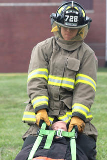 Cody Thompson of the Raywick Fire Department drags a 180-pound dummy 100 feet at the end of the obstacle/relay challenge.