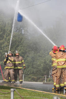 The Raywick Fire Department fights to maintain their position against Northeast Nelson in waterball, in which the teams use a fire hose to push a barrel suspended on a wire. The first team to push the barrel far enough into the other team&#039;s side wins.