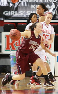 Bre Elder looks for room against Manual's Lauren Bodine.