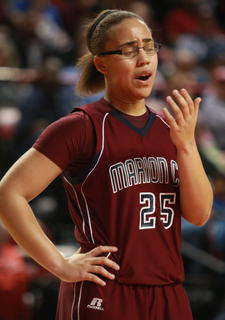 Makayla Epps checks to see if she is bleeding after getting hit in the face during the state championship.