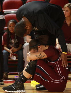 "Assistant Coach Robert ""Boo-B"" Spalding consoles Makayla Epps after the loss."