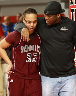 Anthony Epps offers words of encouragement to his daughter, Makayla Epps, following the championship game.