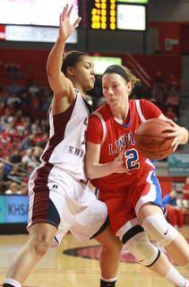 Kyvin Goodin-Rogers defends Lincoln County's Sydney Harris.