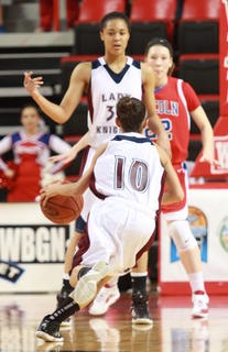 Haeli Howard (No. 10) drives as Kyvin Goodin-Rogers waves her into the lane.