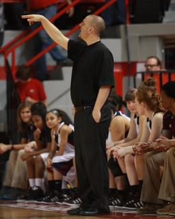 Marion County Coach Trent Milby gives instructions to his players.