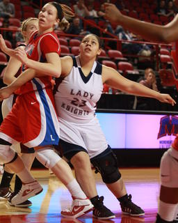Ashley Bridgewater (No. 23) fights for position.
