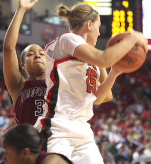Shakila Goodin applies some defensive pressure against Manual's Lauren Bodine.