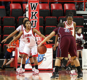 Manual's defense focuses on Makayla Epps in the final minute.