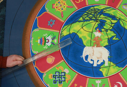 Ngargo Rinpoche uses a ruler to prepare to make the next section of the mandala.