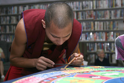 Penzin Dawa puts the final touches on the mandala.