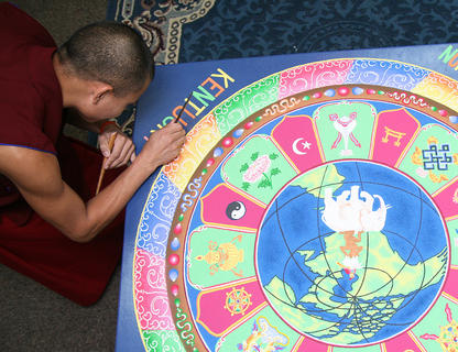 Penzin Dawg puts the final touches on the mandala.