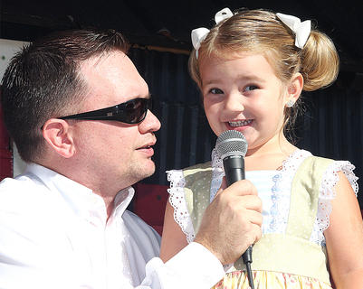 Participant No. 13, Raini Sidebottom, talks to emcee Jeremy Bowman during the Little Miss Ham Days contest. She's the daughter of Derek and Nickie Sidebottom.