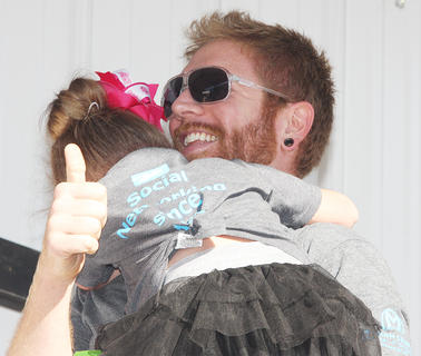 Participant No. 7, Molly Mattingly, experienced some stage fright during the Little Miss Ham Days contest. She is the daughter of Kurt and Amy Mattingly. She's pictured with her father, Kurt.