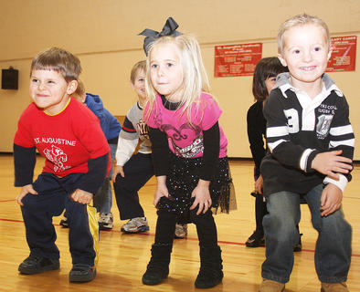 "Preschoolers Owen Daugherty, Chloe Gootee and Drew Morgan do the ""Body Rock."""