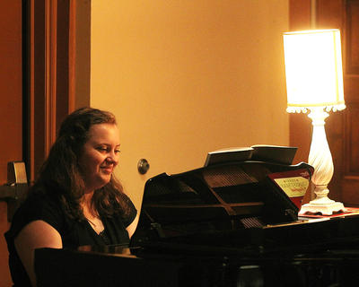 Kelli Evans plays the piano for the Peanuts Gang during portions of the musical.