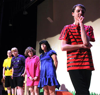 From left, Wesley Marlowe (Charlie Brown), Brandon Curtsinger (Schroeder), Gaubrielle Humphress (Sally Brown), Stevie Lowery (Lucy Van Pelt) anxiously watch as Chance Hovious (Linus) attempts to separate himself from his security blanket.