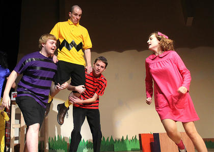 Pictured, from left, are Brandon Curtsinger (Schroeder) and Chance Hovious (Linus Van Pelt) carrying Wesley Marlowe (Charlie Brown) during the opening number. Also pictured is Gaubrielle Humphress (Sally Brown).
