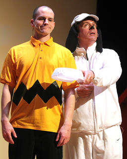 G.B. Dixon (Snoopy) eagerly asks Wesley Marlowe (Charlie Brown) if it's supper time.