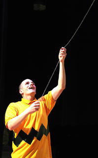Wesley Marlowe, as Charlie Brown, tries his best to fly a kite.