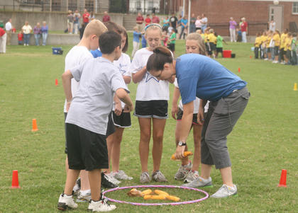 The Glasscock Elementary team talks strategy before the Pig Pen Relay.