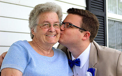 Jordan Hourigan gives his grandmother, Juanita Mills, a kiss on the cheek before heading to prom.