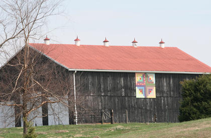 Nancy Miles painted the Log Cabin pattern to reflect the history of the origins of the Sisters of Loretto.