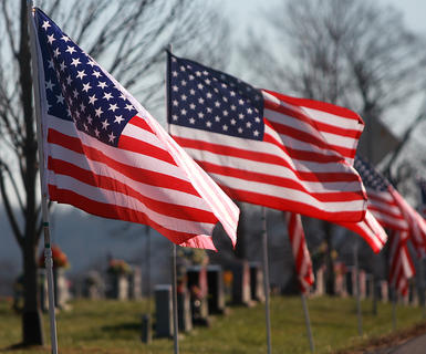 Flags were placed throughout the Old Liberty Cemetery in honor of Deputy Anthony Rakes.