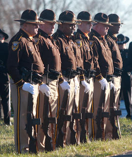 The Jefferson County Sheriff&#039;s Honor Guard stood at attention awaiting Rakes arrival at the Old Liberty Cemetery.