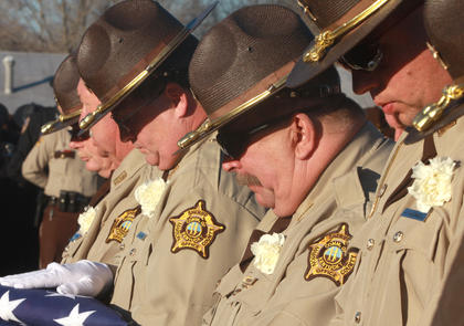 Members of the Marion County Sheriff's Department honor their fellow officer at the Old Liberty Cemetery.